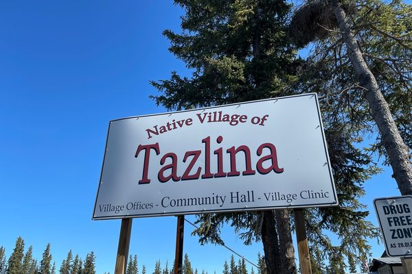 This April 22, 2021, photo, shows a sign in tiny Tazlina, Alaska, northwest of Anchorage. The Native Village of Tazlina, a federally recognized tribe, is trying to raise money so it can buy 460 acres of ancestral lands from the Archdiocese of Anchorage-Juneau. The land once held a mission school. (John Tierney/Indian Country Today via AP)