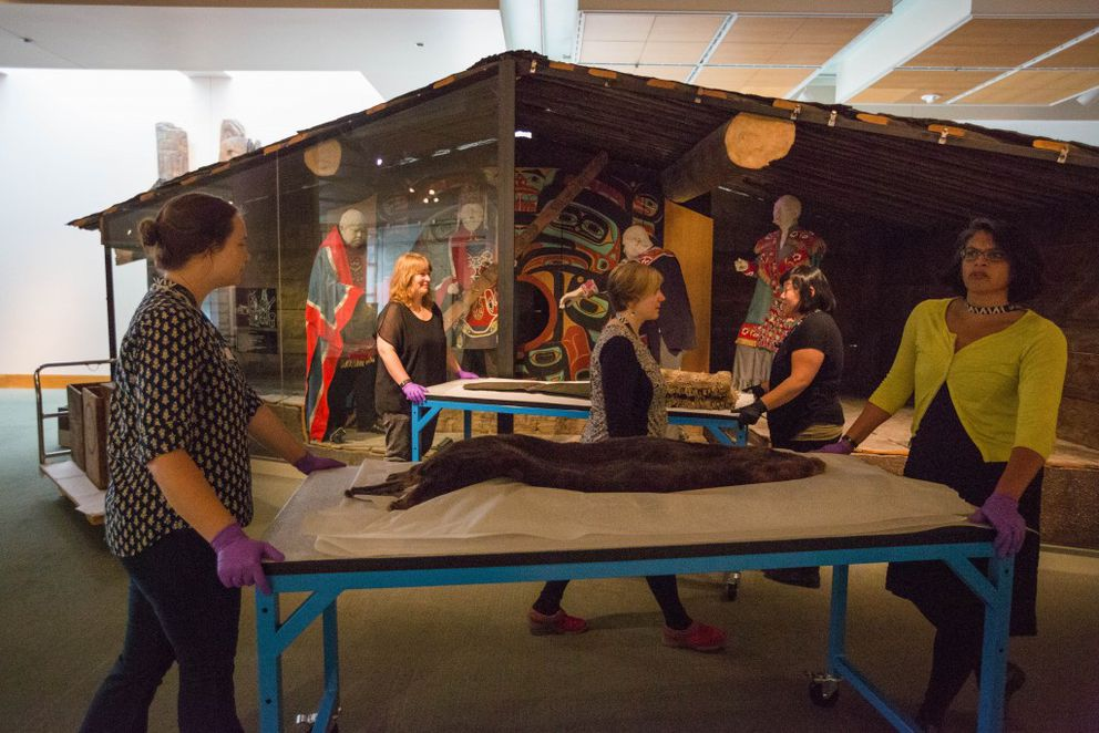 Objects from the Alaska Gallery are transported to a temporary space on the first floor of the Anchorage Museum on Wednesday, Aug. 10, 2016. (Loren Holmes / Alaska Dispatch News)