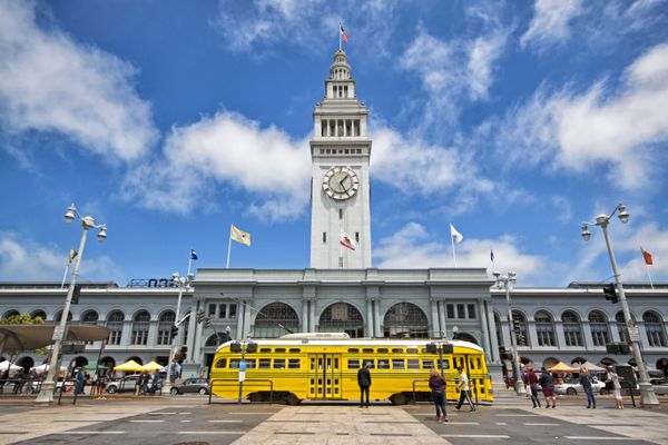 A streetcar painted in honor of Cincinnati's transit line passes San Francisco's Ferry Building in June 2016. MUST CREDIT: Photo for The Washington Post by Justin Franz