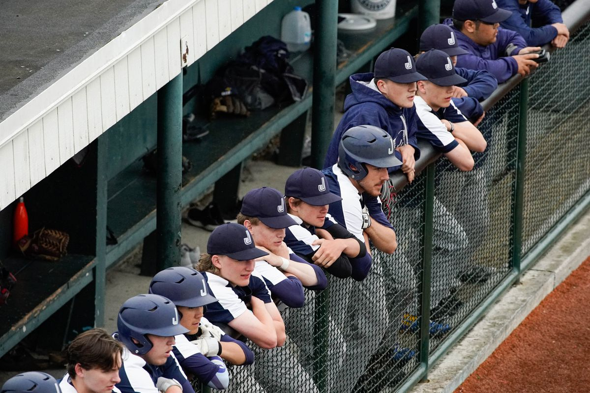The Juneau Midnight Suns watch the action during an Alliance Baseball League state tournament game against the West Eagles on Friday, July 24, 2020 at Mulcahy Stadium. (Loren Holmes / ADN)