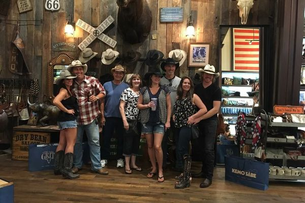 Robert Murphy, 46, of Skagway, far right, offered a new account Tuesday of his efforts to help save victims of the mass shooting at the Las Vegas music festival. He's standing with his wife, Christy Murphy, and friends at a shop on the Las Vegas Strip. (Courtesy Robert Murphy)