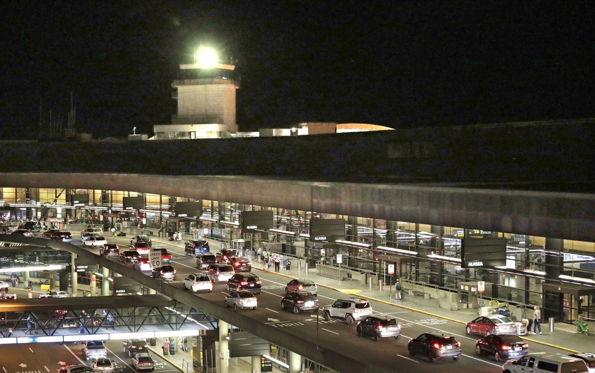 Traffic arrives at Sea-Tac International Airport terminal Friday evening, Aug. 10, 2018, in SeaTac, Wash. An airline mechanic stole an Alaska Airlines plane without any passengers and took off from Sea-Tac International Airport in Washington state on Friday night before crashing near Ketron Island, officials said.(AP Photo/Elaine Thompson)