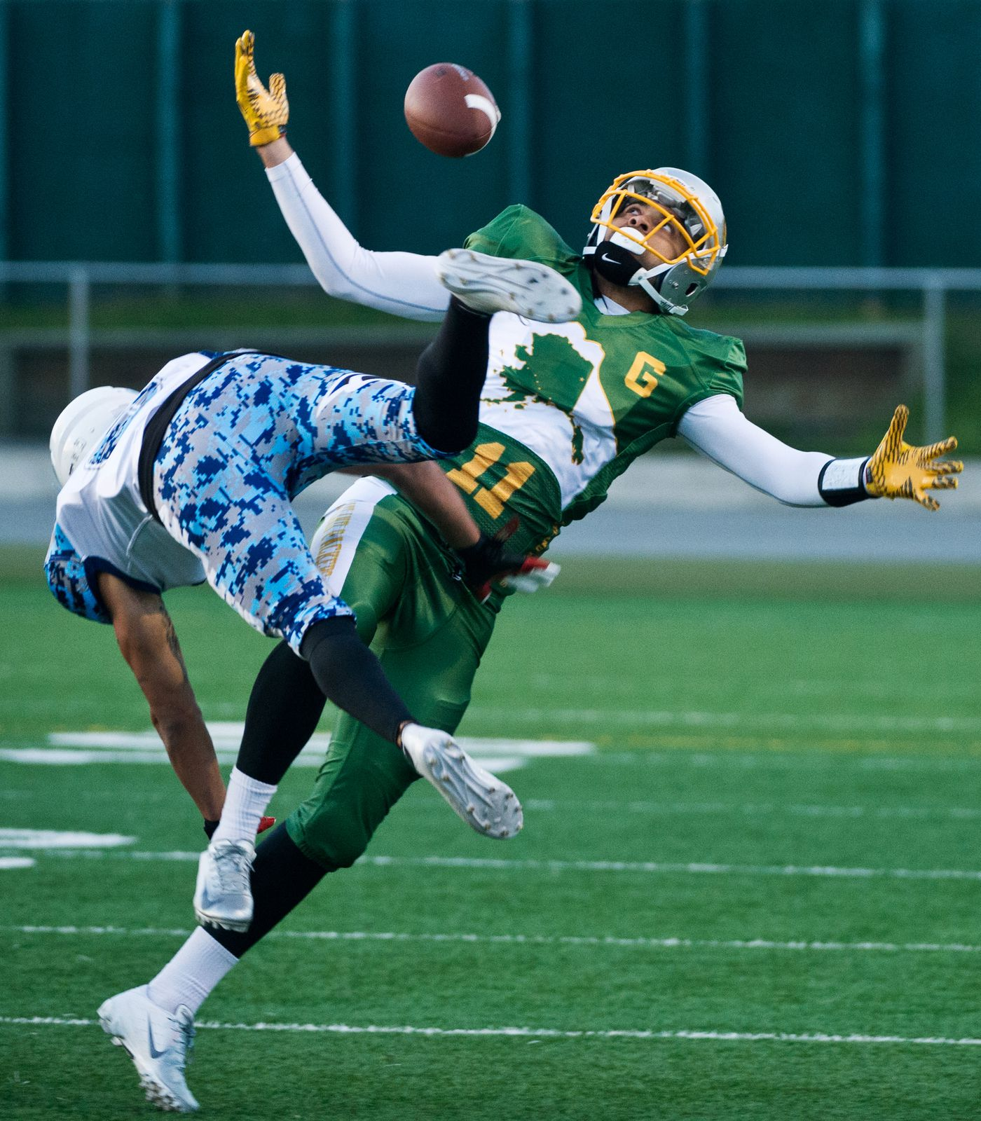 Greatland Packers receiver Damon Sherman-Newsome tries to pull in a pass over defense from Joey McMahon of the Anchorage Cowboys on Sept.3, 2018. (Marc Lester / ADN)