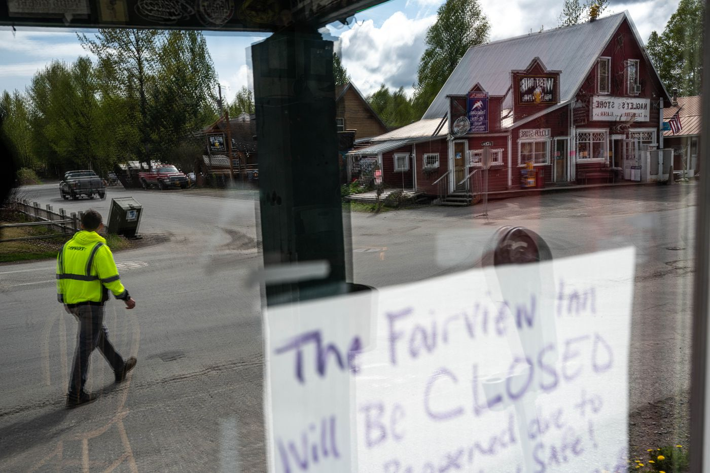 MAY 21. Main Street is reflected in a window of the closed Fairview Inn in Talkeetna. The popular bar has been closed because of the COVID-19 pandemic. (Loren Holmes / ADN)