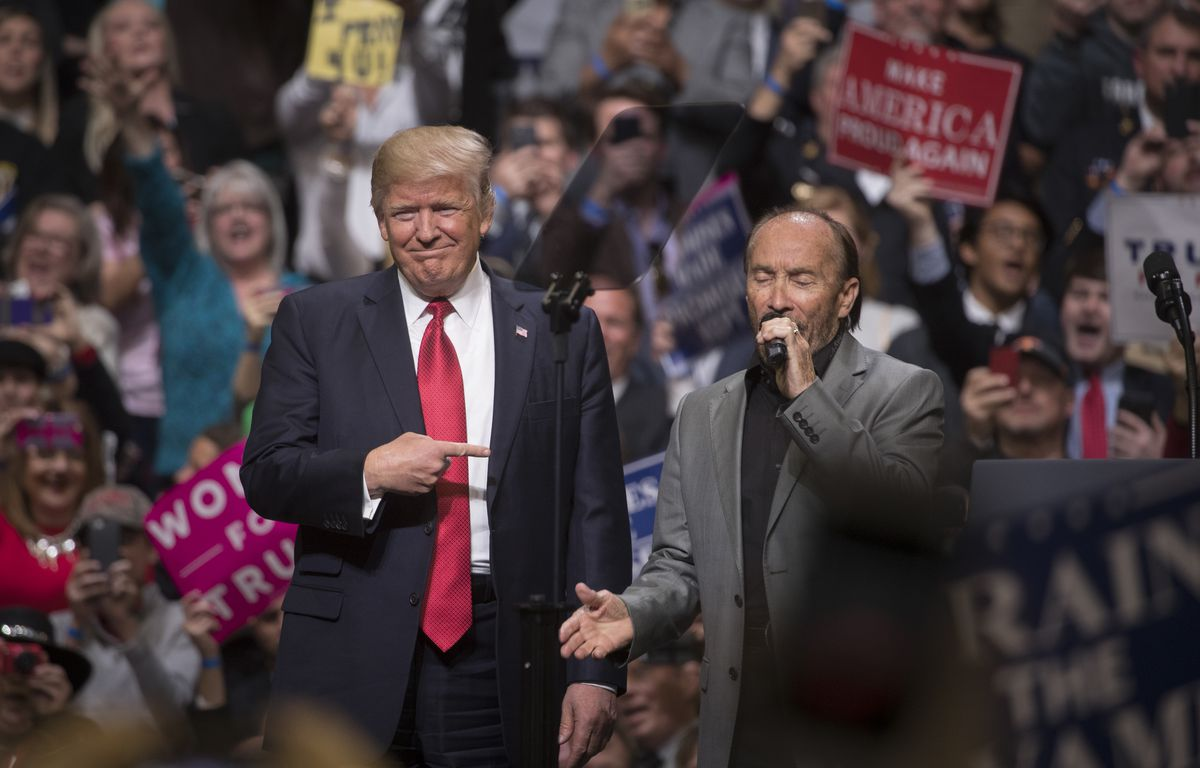 President Donald Trump with singer Lee Greenwood during a rally at the Nashville Municipal Auditorium in Nashville, Tenn., on Wednesday. (Stephen Crowley/The New York Times)