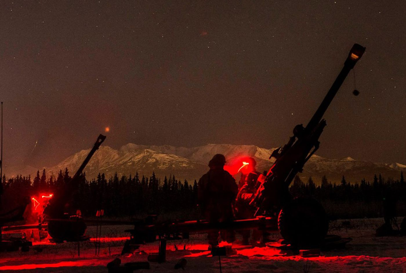 U.S. Army paratroopers assigned to 4th Brigade Combat Team (Airborne), 25th Infantry Division fire 105mm howitzers during a 2014 night-fire training event at Joint Base Elmendorf-Richardson, Alaska. (U.S. Army photo by Staff Sgt. Daniel Love)