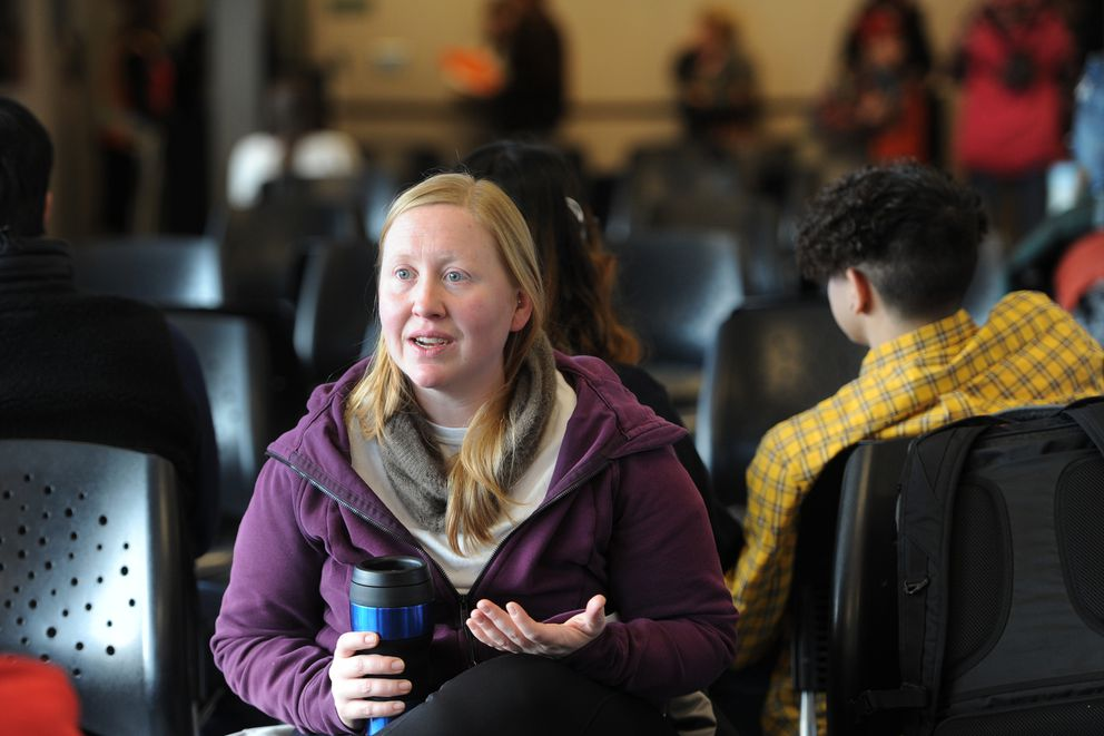 Speech therapist Toni Rae Osiecki waits in the terminal for a Ravn Alaska flight bound for Dutch Harbor during weather delays on Thursday, Dec. 5, 2019. (Bill Roth / ADN)