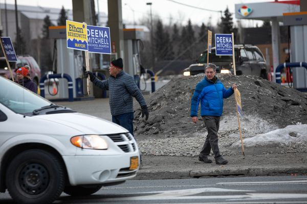 Anchorage mayor Ethan Berkowitz waves signs on election day, Tuesday, April 3, 2018. Berkowitz is running for a second term. (Loren Holmes / ADN)
