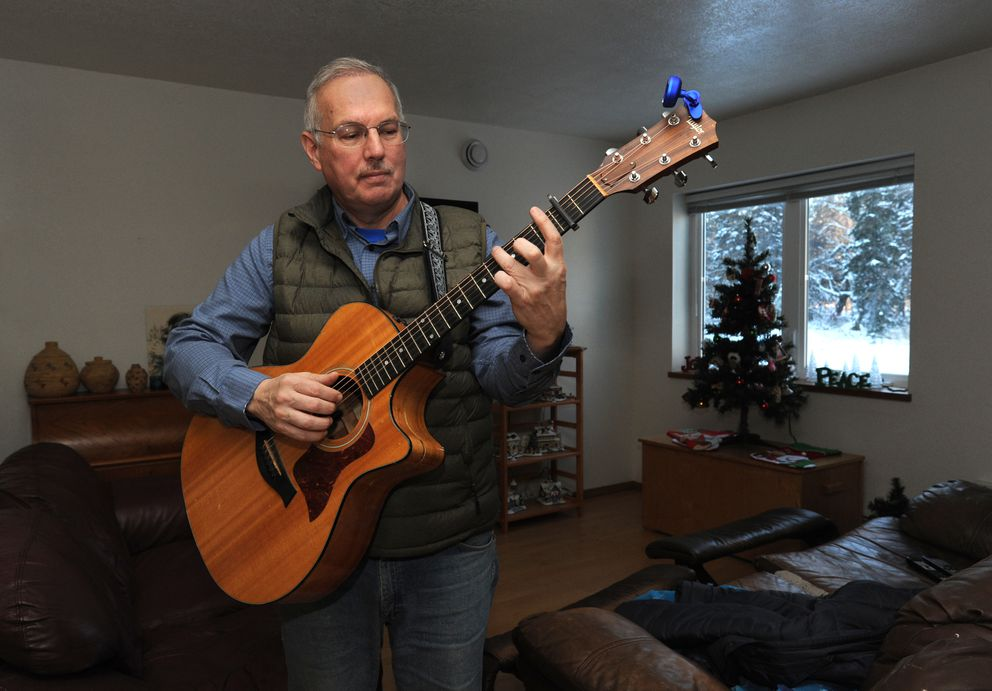 A lifelong musician, Bryce Edgmon plays his Taylor cutaway guitar at home in Dillingham. Edgmon promises there will be a guitar in his Speaker of the House office. (Erik Hill / Alaska Dispatch News)