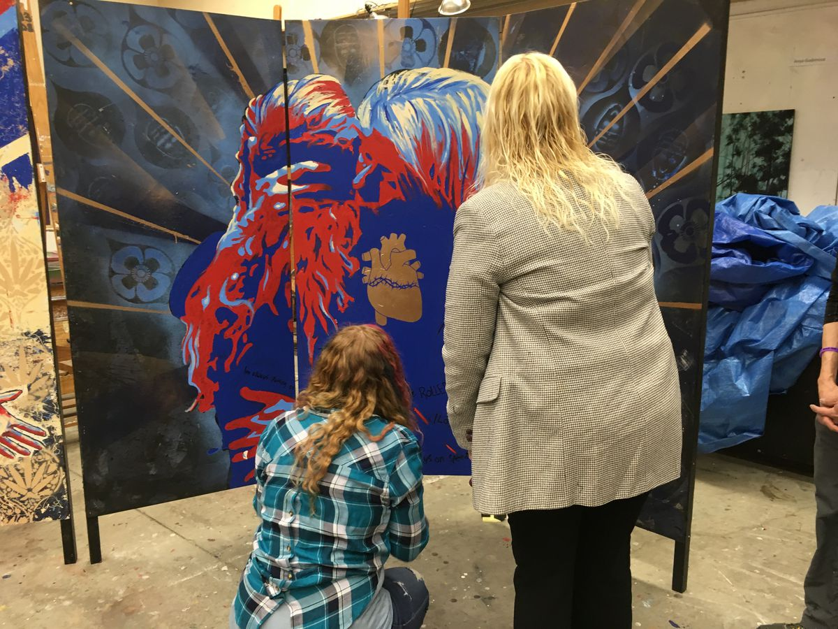 Kim Whitaker, right, and her daughter view a mural depicting them made by students of art teacher Steve Gordon on Feb. 7, 2018. The work is intended to draw attention to the opioid crisis. (Charles Wohlforth / ADN)