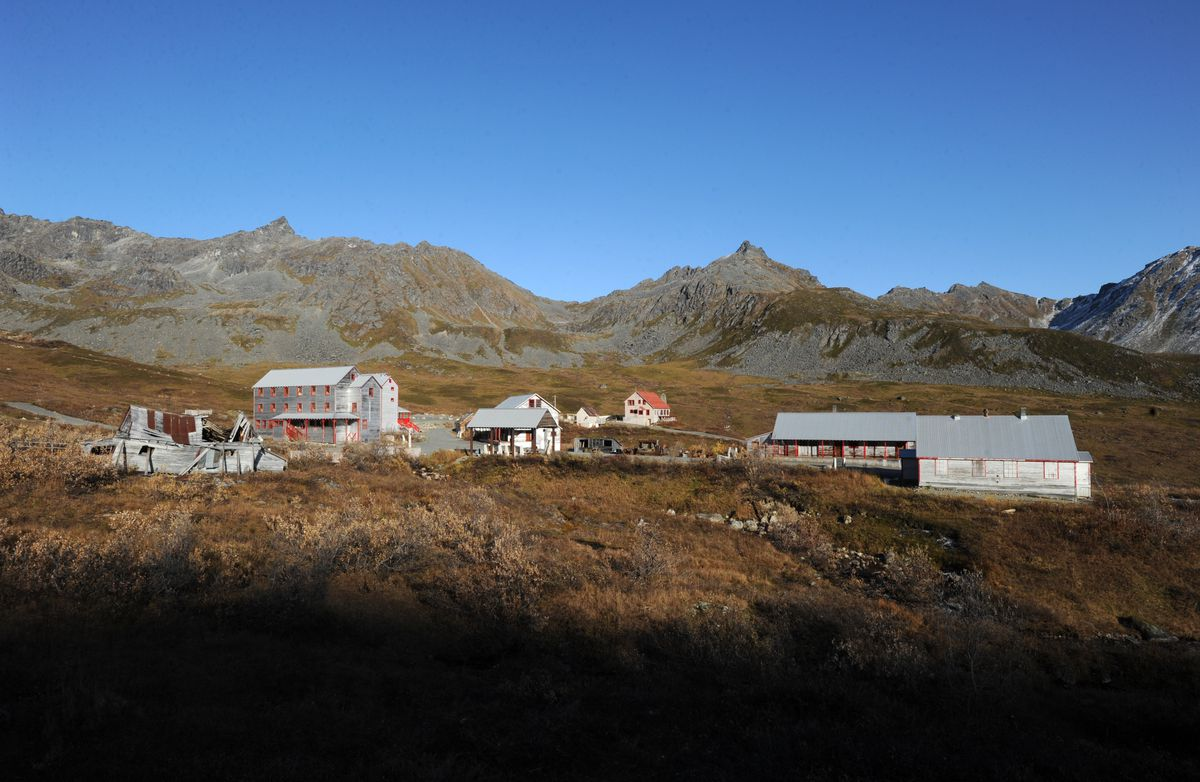 The setting sun illuminates buildings at the Independence Mine State Historical Park at Hatcher Pass on Oct. 1, 2014. (Bill Roth / ADN archive)