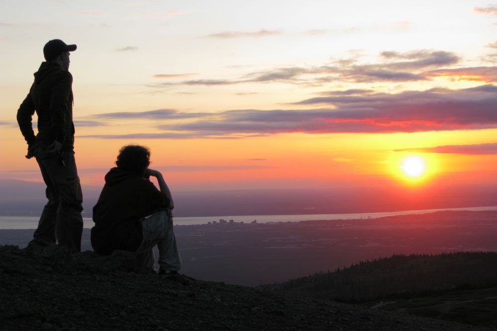 Hikers take in the sunset at about 11:30 p.m. on the summer solstice, Friday, June 20, 2008. Late-day sun brightened a hike up Flattop Mountain in Chugach State Park on the summer solstice on Friday, June 21, 2008. Hiking Flattop is a solstice tradition for many in Anchorage and a way to enjoy some the 19 hours, 21 minutes and 17 seconds of daylight. (Marc Lester / Anchorage Daily News)