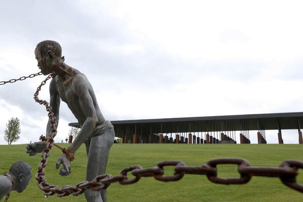 FILE - In this Sunday, April 22, 2018, file photo, a statue of a chained man is on display at the National Memorial for Peace and Justice, a new memorial to honor thousands of people killed in racist lynchings, in Montgomery, Ala. Facing an impeachment inquiry that he and supporters claim is illegal, President Donald Trump tweeted Tuesday, Oct. 22, 2019, that the process is a lynching. Some Republicans agree, but the relatives of actual lynching victims don't. (AP Photo/Brynn Anderson, File)