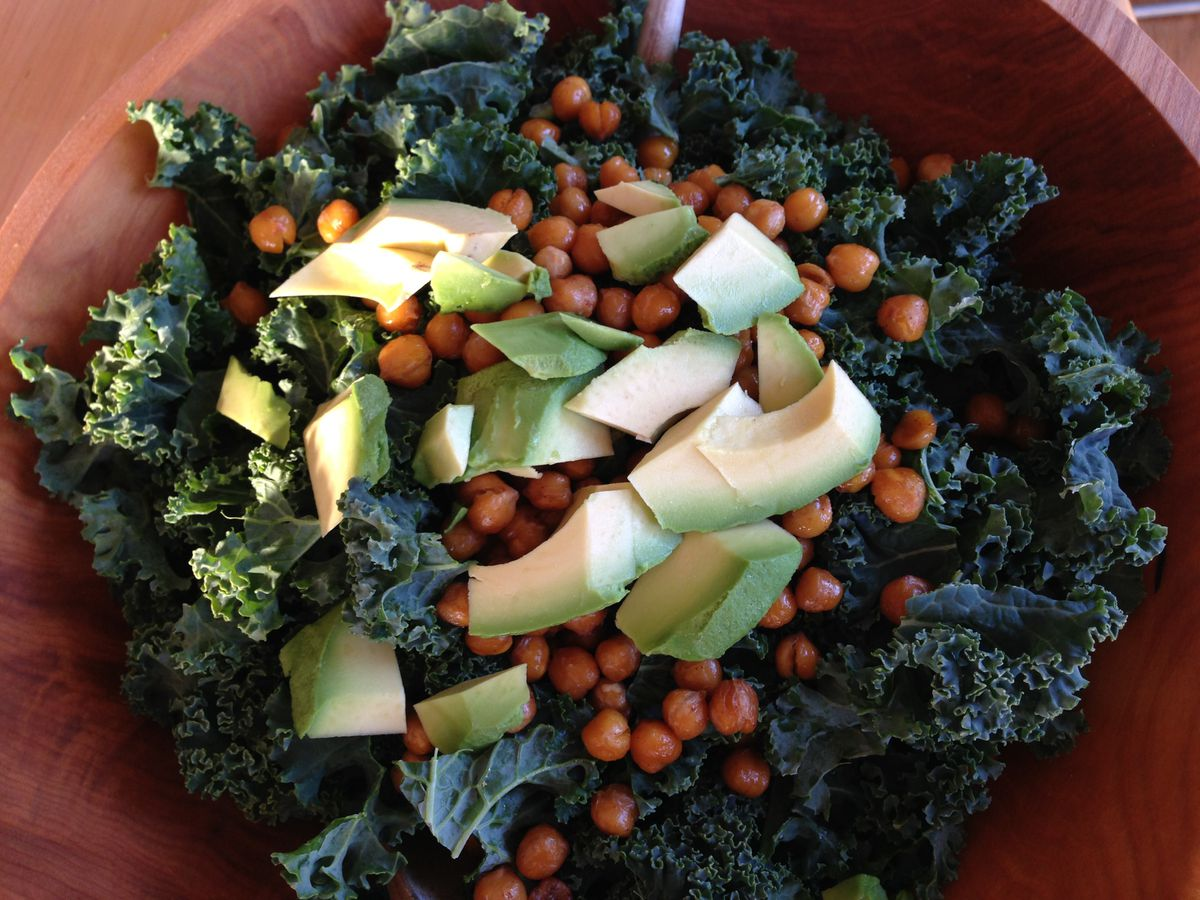 Lemon-hot sauce kale salad with chickpeas and avocado. (Julia O'Malley / ADN)