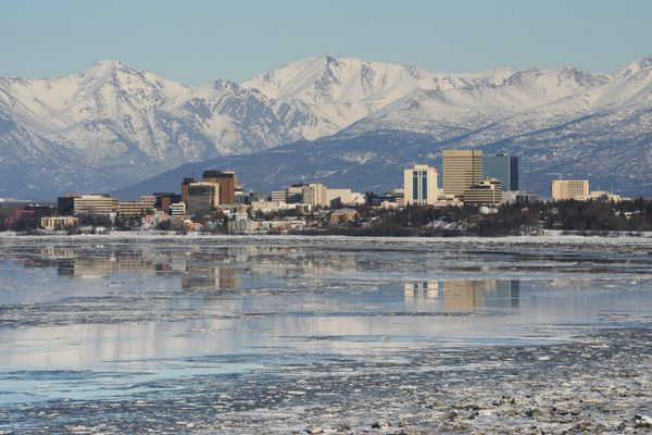 The Anchorage skyline is reflected on an incoming tide on Monday, Mar. 4, 2019. (Bill Roth / ADN)