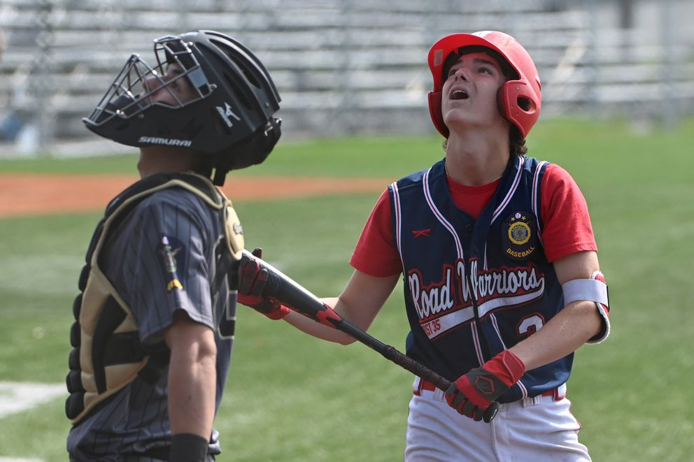 South catcher Josh Costello and Wasilla batter Logan Bailey look up at a foul ball during the Road Warriors' 11-1 victory over the South Wolverines to advance to the final of the Alliance Baseball League state tournament at Mulcahy Stadium on Tuesday afternoon, July 28, 2020. (Bill Roth / ADN)
