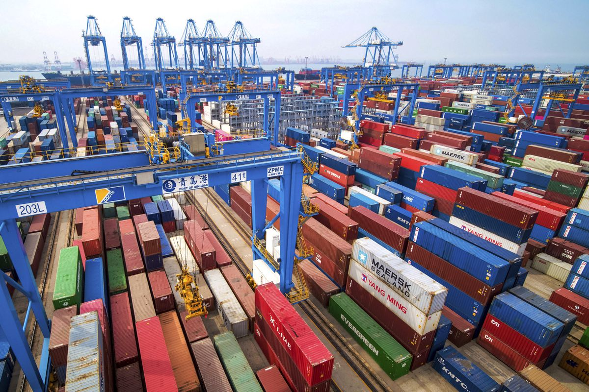 In this Tuesday, May 14, 2019, photo, containers are piled up at a port in Qingdao in east China's Shandong province. (Chinatopix via AP)