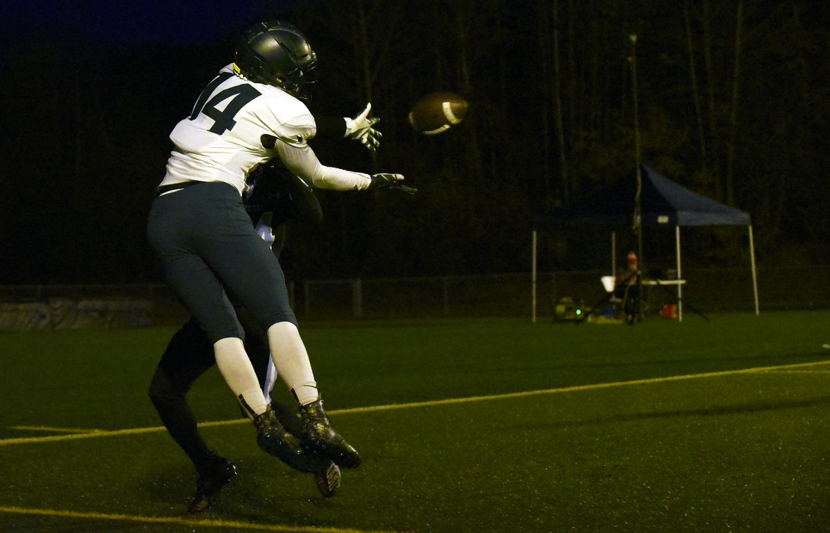 Service's Henry Helgeson makes a leaping touchdown catch during Service's 42-7 win over Chugiak in the first round of the ASAA/First National Bank Alaska Division I Football Playoffs at Tom Huffer Sr. Stadium in Chugiak. (Matt Tunseth / Chugiak-Eagle River Star)