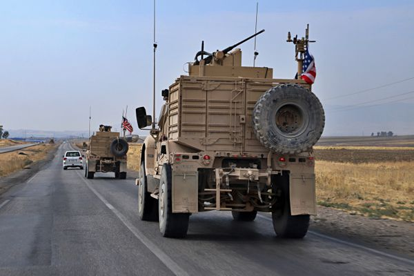 A U.S. military convoy arrives near Dahuk, Iraqi, Monday, Oct. 21, 2019. Defense Secretary Mark Esper said Monday that under the current plan all U.S. troops leaving Syria will go to western Iraq and the military will continue to conduct operations against the Islamic State group to prevent its resurgence. (AP Photo)