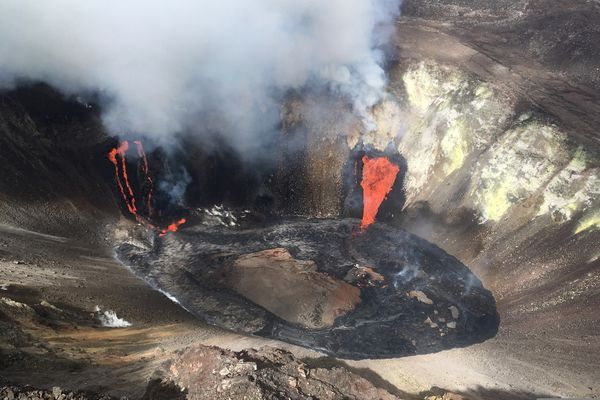 A plume rises near active fissures in the crater of Hawaii's Kilauea volcano on Monday, Dec. 21, 2020. People are lining up to try to get a look at the volcano on the Big Island, which erupted last night and spewed ash and steam into the atmosphere. A spokeswoman for Hawaii Volcanoes National Park says the volcanic activity is a risk to people in the park Monday and that caution is needed. (M. Patrick/U.S. Geological Survey via AP)