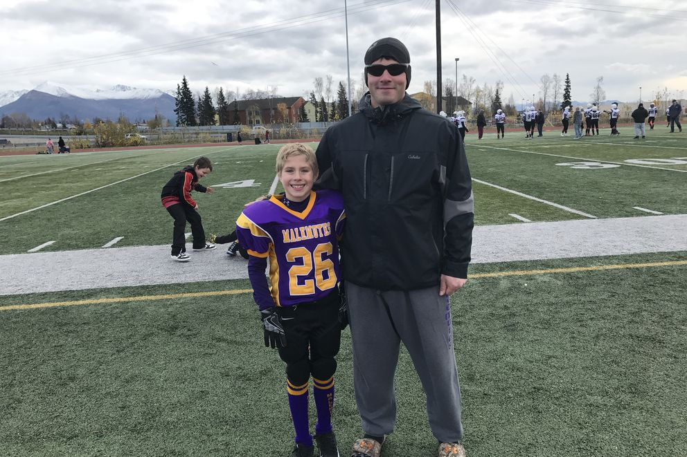 Perry Monzulla and his son Talon Loving at Clark Middle School on Saturday, Oct. 14, 2017.
