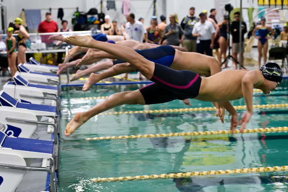 Racers enter the pool for one of 80 heats. (Marc Lester / ADN)