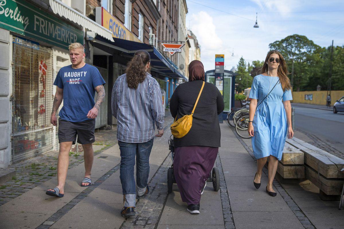 People on a street in the Norrebro neighborhood of Copenhagen, Denmark, Aug. 5, 2016. (Ilvy Njiokiktjien/The New York Times file)