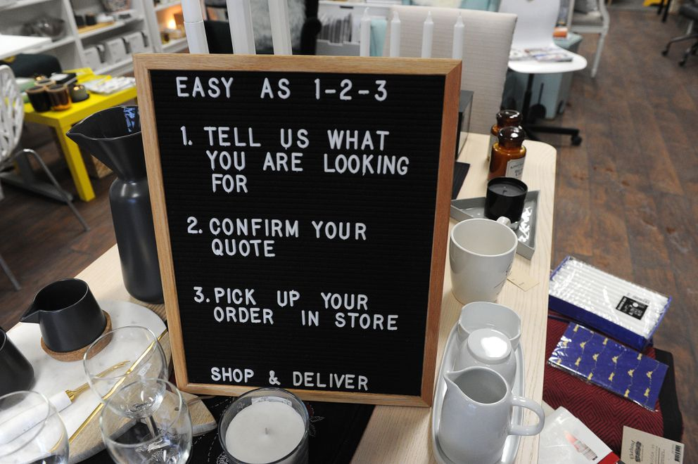 A sign sits in Erika Klaar and Michael Matteson's Shop and Deliver by Lulu storefront in Anchorage on Thursday, Jan. 19, 2018. (Bob Hallinen / ADN)