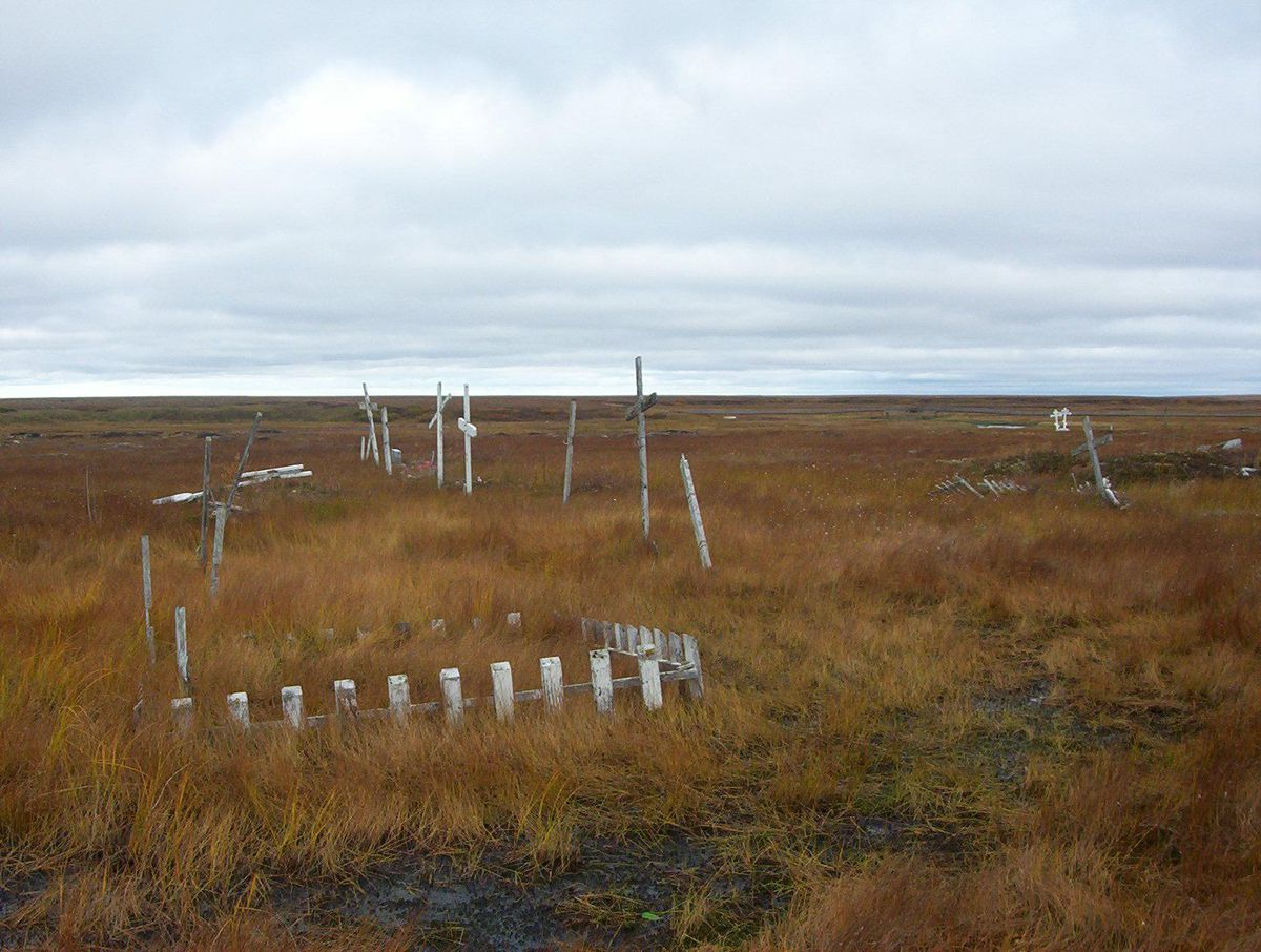 As the permafrost thaws, Kongiganak's cemetery is turning into swampland. (Teresa Cotsirilos / KYUK)