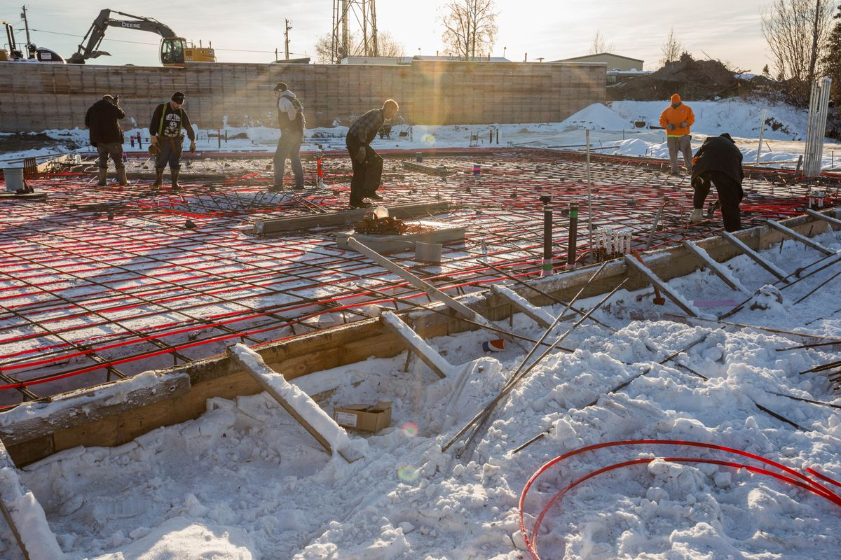 Workers prepare rebar and radiant floor heating at the site of the Culmination Building in south Anchorage Tuesday. (Loren Holmes / Alaska Dispatch News)