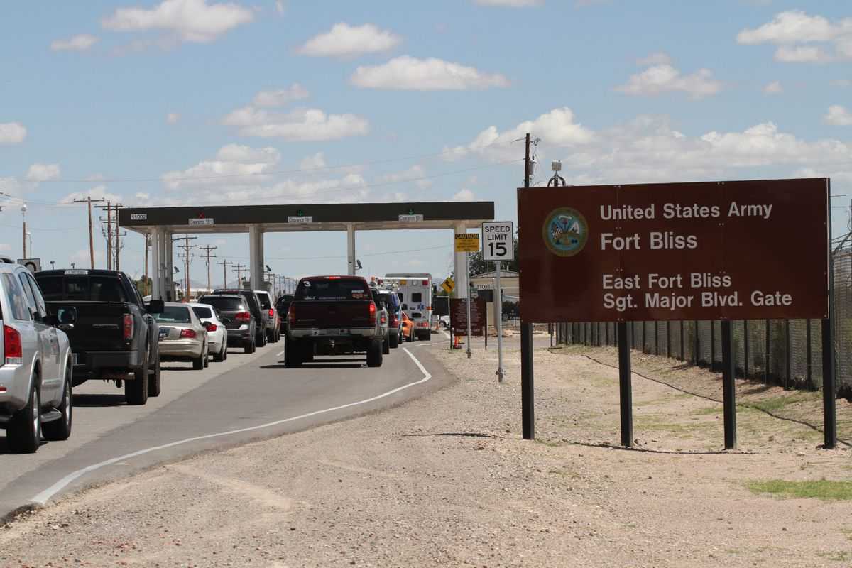 In this Sept. 9, 2014, file photo, cars wait to enter Fort Bliss in El Paso, Texas. (AP Photo/Juan Carlos Llorca, File)