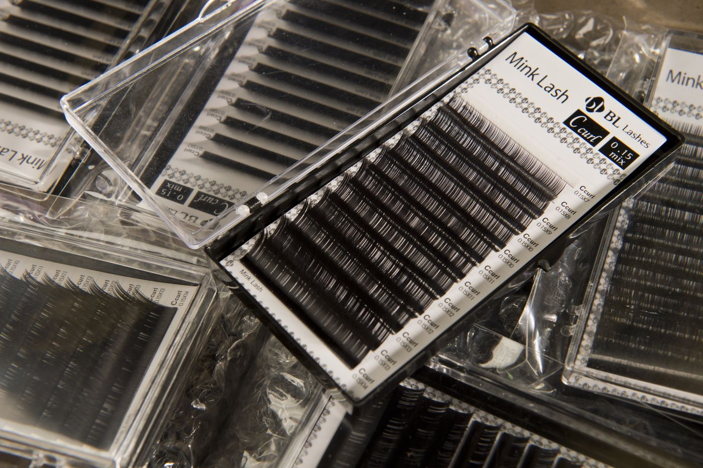 Supervisory wildlife inspector Chris Andrews said they've confiscated seven boxes – about 500 sets – of false eyelashes made from mink. Importers did not have the proper license to import the product from China. (Marc Lester/ ADN)