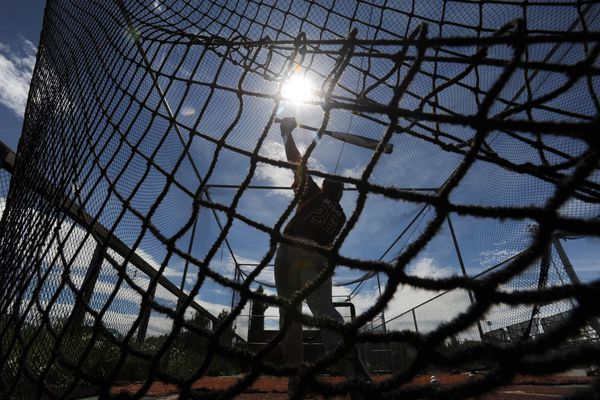 Kaden Roettger of Dimond Post 21 works on his swing while hitting baseballs inside a batting cage during the Alaska Legion Baseball Coaches Camp at Mulcahy Stadium on Wednesday, June 20, 2018. The camp is celebrating its 25th year after being formed by the late Chugiak Post 33 manager Bill Lierman Sr. who worked to grow youth baseball in Alaska and provide local players with exposure to college coaches without leaving the state. A select group of Alaska Legion players from the 4-day camp will play a game against the Anchorage Bucs of the Alaska Baseball League on Summer Solstice, Thursday, June 21. (Bill Roth / ADN)