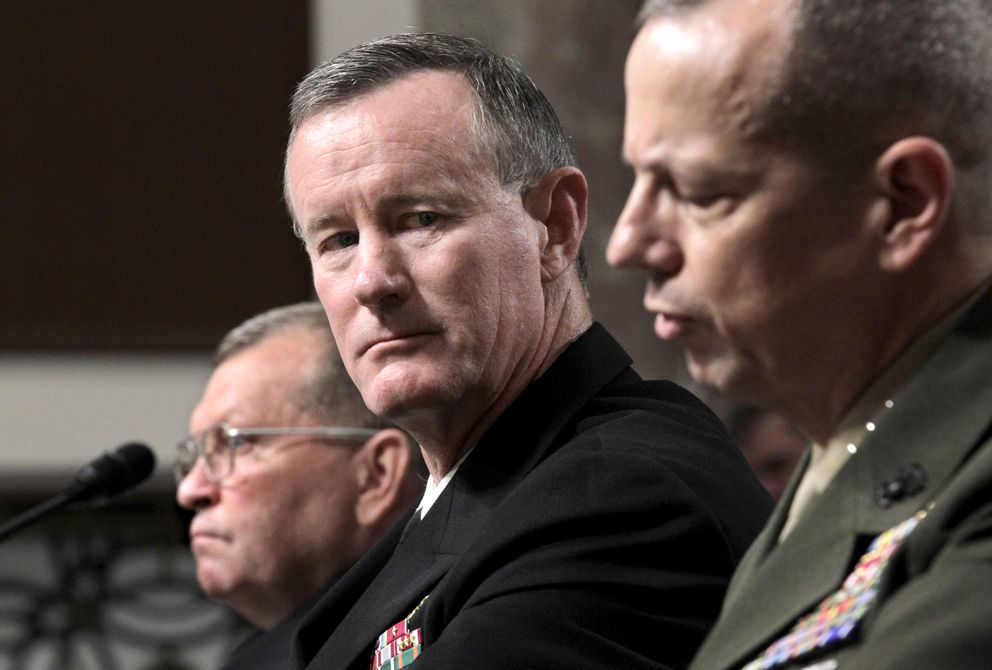 Retired Gen. William H. McRaven, center, listens to testimony by Marine Lt. Gen. John Allen, right, during a confirmation hearing on Capitol Hill in Washington, Tuesday, June 28, 2011. At left is Gen. James D. Thurman. (AP Photo/J. Scott Applewhite)