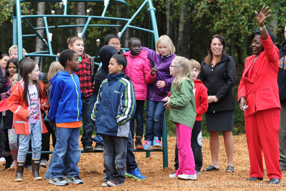 Former Sen. Bettye Davis, right, who helped secure funding for playground equipment, meets third graders from nearby Scenic Park Elementary School at a ribbon cutting Thursday afternoon, September 12, 2013, in Scenic Park.