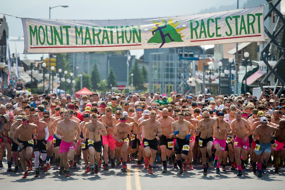 Runners in the first wave of the Mount Marathon men's race leave the starting line on July 4, 2019, in Seward. (Marc Lester / ADN)