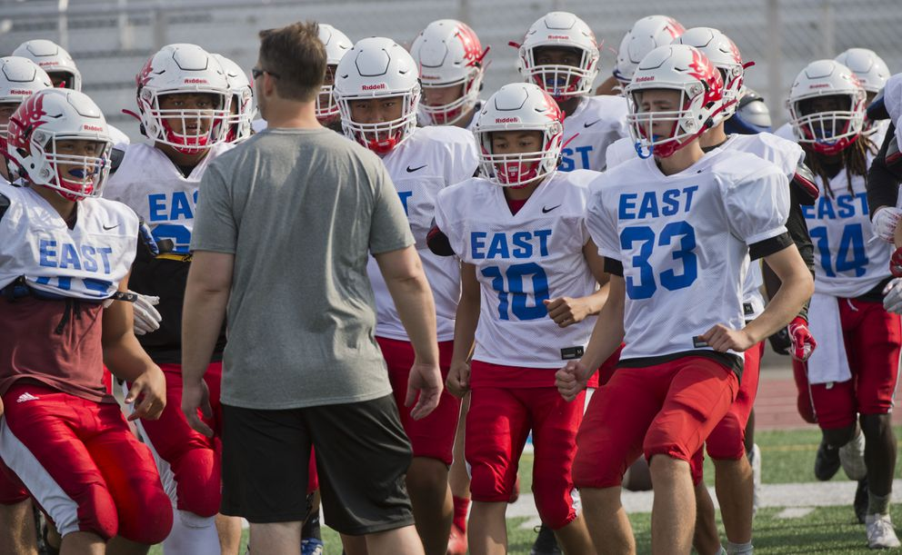 Coach Jeff Trotter talks to his team Wednesday. (Marc Lester / ADN)