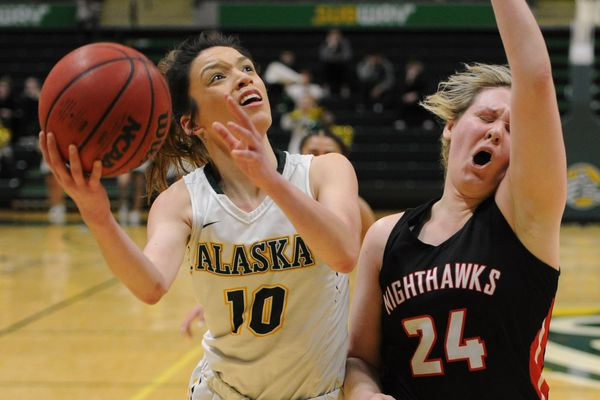 UAA junior guard Yazmeen Goo drives to the basket as Northwest Nazarene senior Danielle Jardine defends during the Seawolves' 64-55 home victory at the Alaska Airlines Center on Thursday, Feb. 28, 2019. (Bill Roth / ADN)