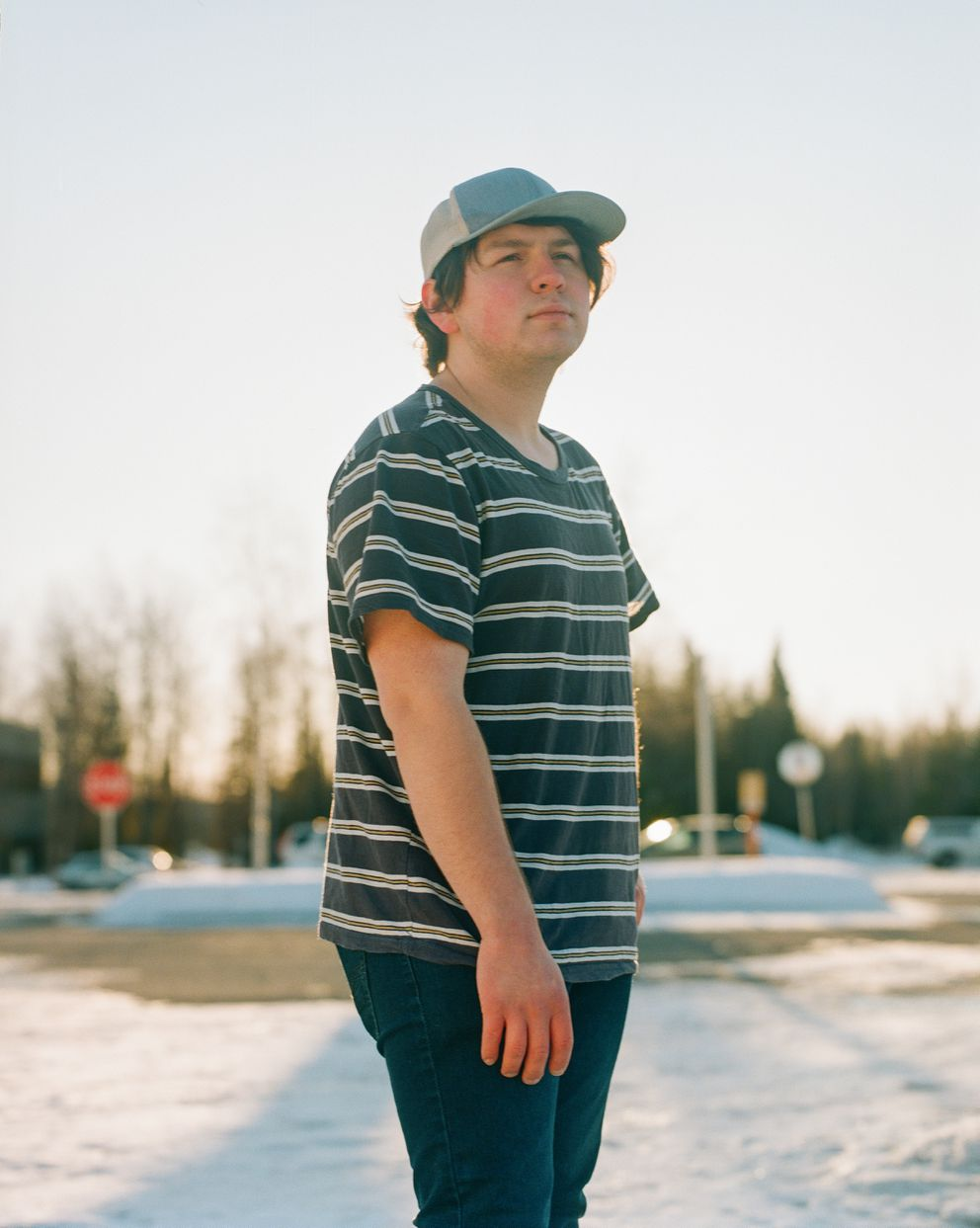 Mateo Jaime, 19, on the campus of the University of Alaska Anchorage, where he attends school, on April 5. He says that he plans to go to medical school after obtaining his undergraduate degree. (Ash Adams for The Marshall Project and NPR)