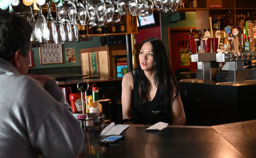 Humpy's bartender Brandy Bruce works the bar Monday, March 16, 2020. She's been tending bar at Humpy's for 8 years. (Anne Raup / ADN)