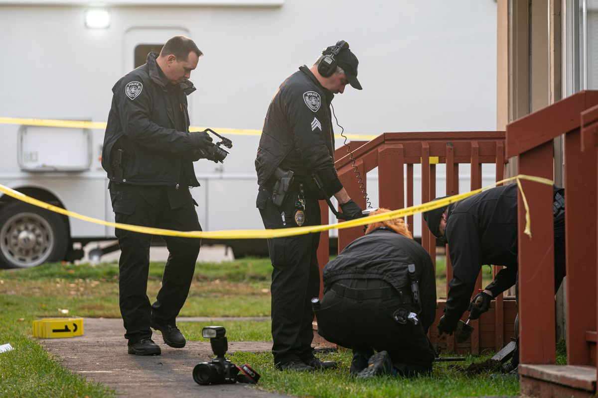 Anchorage police use a metal detector to look for bullets during a homicide investigation in East Anchorage on Wednesday morning, Oct. 7, 2020. One person died and four were injured in the early morning shooting, according to a release from the police. (Loren Holmes / ADN)