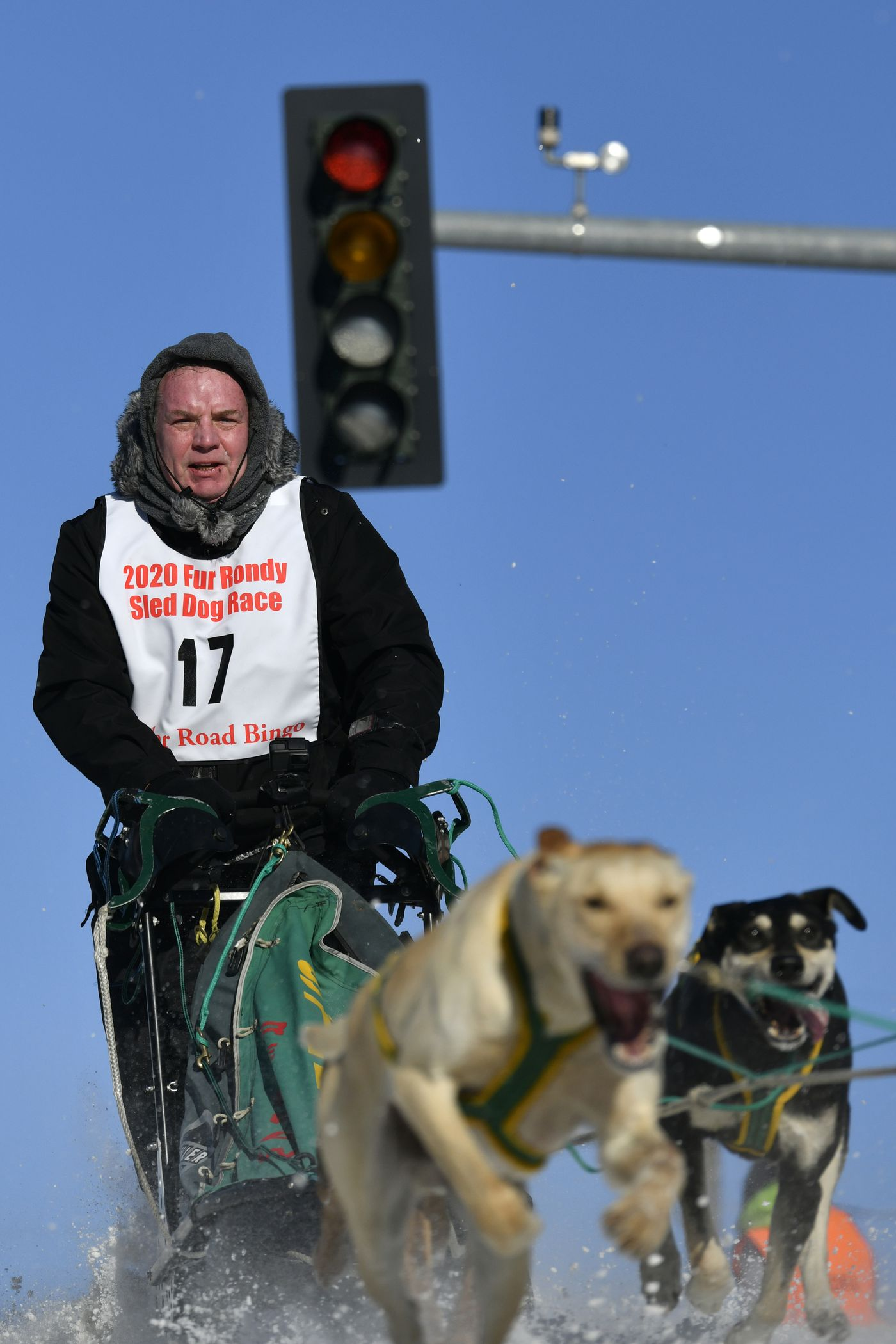 Tony Blanford of Anchorage and his team run down a hill on Cordova Street. (Marc Lester / ADN)
