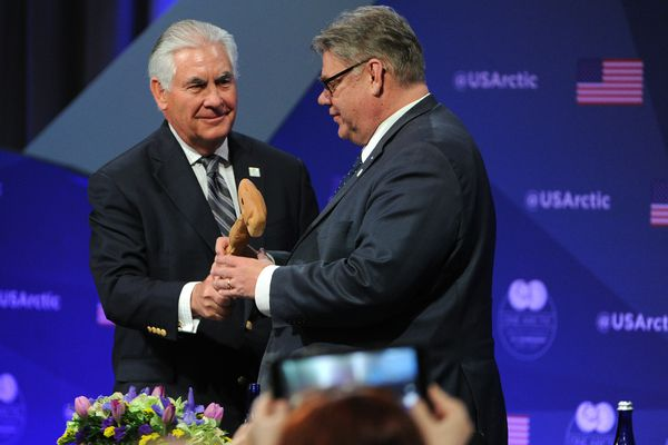 U.S. Secretary of State Rex Tillerson hands the gavel to the Minister of Foreign Affairs of Finland, Timo Soini, as the chair of the Arctic Council is passed to Finland at the Carlson Center in Fairbanks, Alaska on Thursday, May 11, 2017. (Bob Hallinen / Alaska Dispatch News)