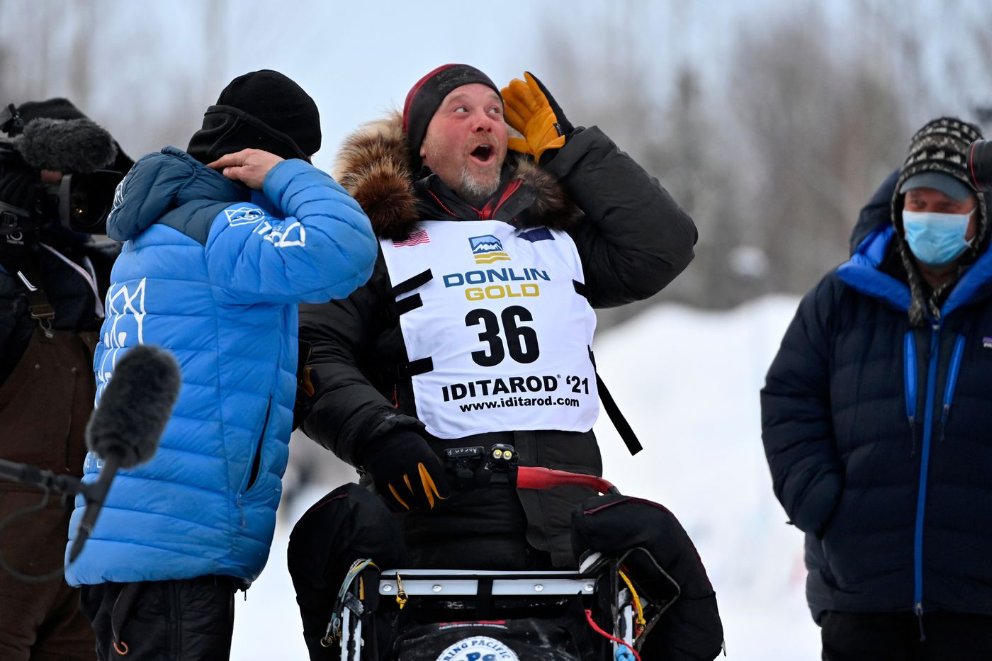Aaron Burmeister, right, talks with Iditarod race winner Dallas Seavey after Burmeister arrived in Willow in second place Monday morning. (Marc Lester / ADN)