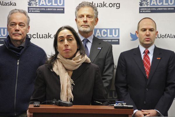 Former Alaska Assistant Attorney General Elizabeth Bakalar speaks during a news conference Thursday, Jan. 10, 2019, in Anchorage, Alaska. She is one of three former state employees who are claiming wrongful termination after they were fired by the new administration of Alaska Gov. Mike Dunleavy. The three are being represented in their lawsuits by the American Civil Liberties Union of Alaska. Also pictured behind her from left are another plaintiff, former Alaska Psychiatric Institute staff psychiatrist Dr. John Bellville, and ACLU of Alaska officials Stephen Koteff and Joshua Decker. (AP Photo/Mark Thiessen)
