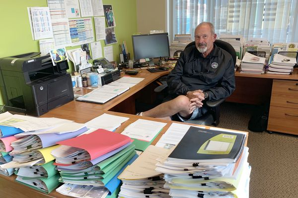 Anchorage Parks and Recreation Director John Rodda sits at his desk in City Hall on Sept. 11, 2019. Rodda is retiring Sept. 30. (Matt Tunseth / Chugiak-Eagle River Star)