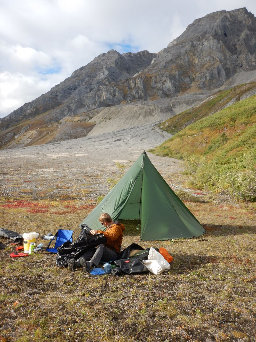 Wrangell-St. Elias National Park and Preserve geologist Mike Loso at base camp. Behind him rise the mountains where an ichthyosaur was rediscovered. (Pat Druckenmiller)