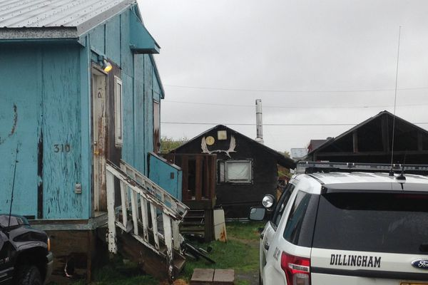 A Dillingham residence remained closed off as a crime scene Wednesday morning as police waited for a warrant. Reece Johnson, 21, was ultimately arrested in the injury shooting of 23-year-old Isiah Thompson.