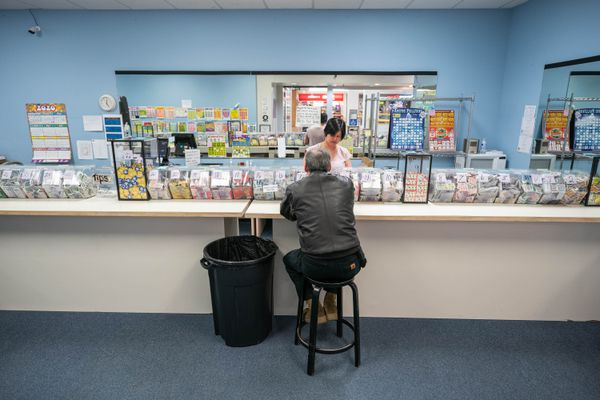 Nhan Ton works at Arctic Pulltabs in the Dimond Center mall on Wednesday, March 18, 2020 in Anchorage. (Loren Holmes / ADN)