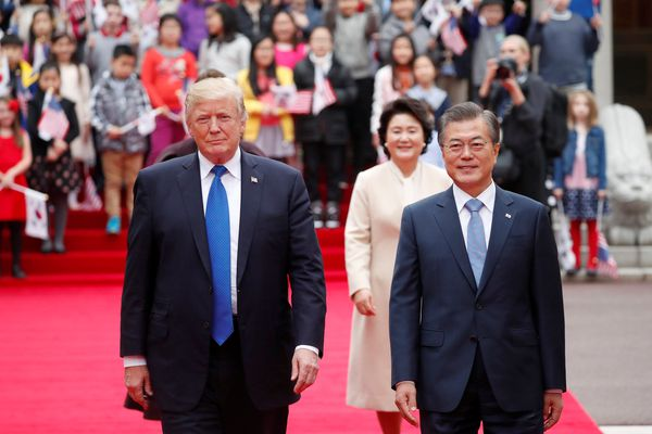 U.S. President Donald Trump walks with South Korea's President Moon Jae-in during a welcoming ceremony at the Presidential Blue House in Seoul, South Korea, November 7, 2017. REUTERS/Kim Hong-Ji